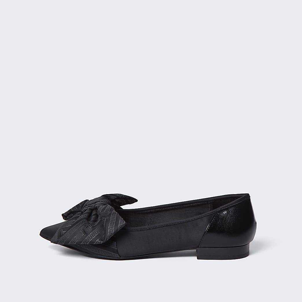 Black oversized bow flat shoes