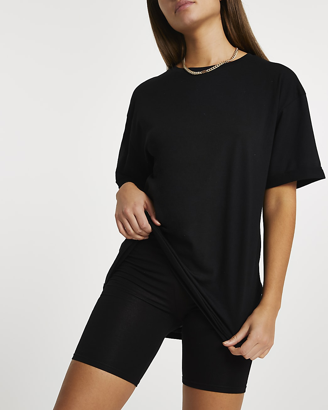Black oversized t-shirt and cycling shorts