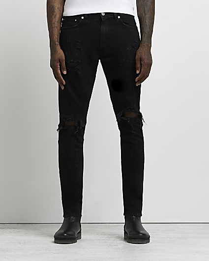Black paint ripped relaxed skinny fit jeans