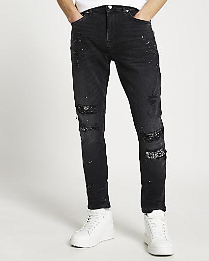 Black paint splat ripped slim-skinny jeans