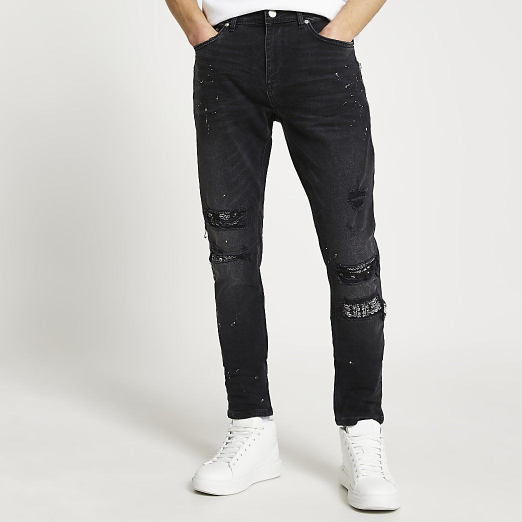 Black paint splat ripped slim-skinny jeans