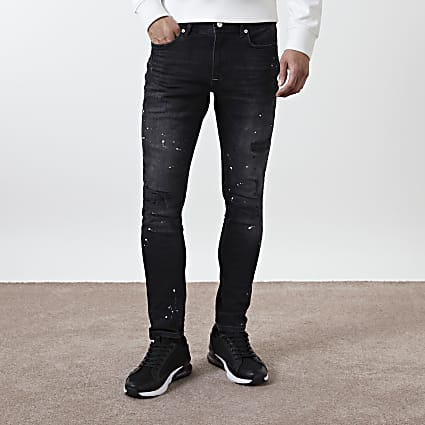 Black paint splat skinny fit jeans