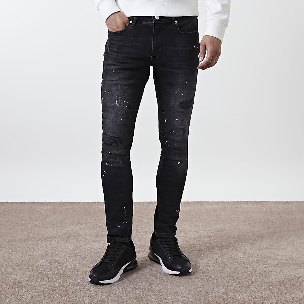 Black paint splat skinny fit jeans