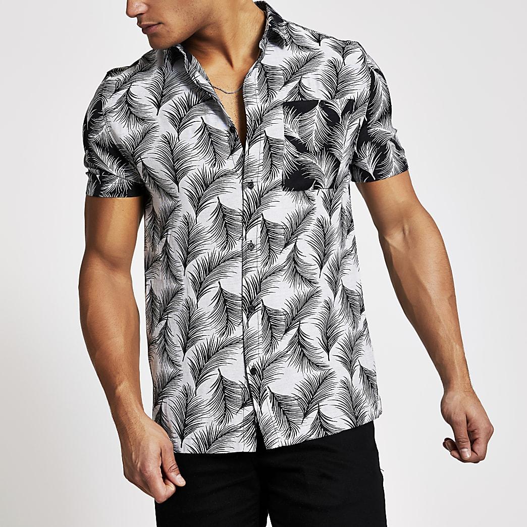 Chemise slim noire impriméfeuilles de palmier