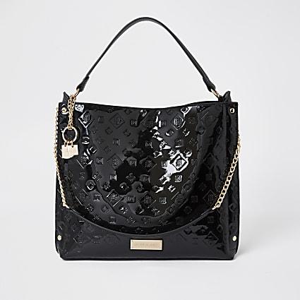 Black patent embossed slouch handbag