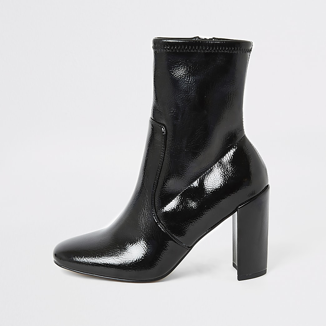 Black patent heeled sock boots
