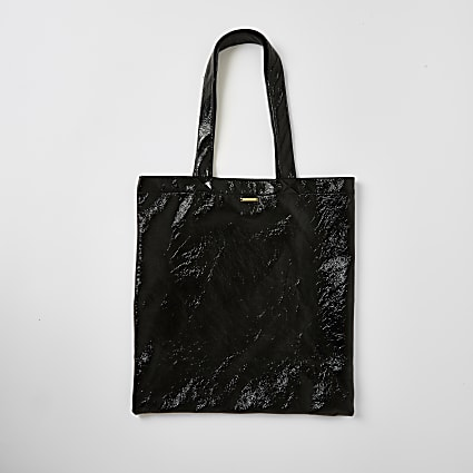 Black patent textured tote bag