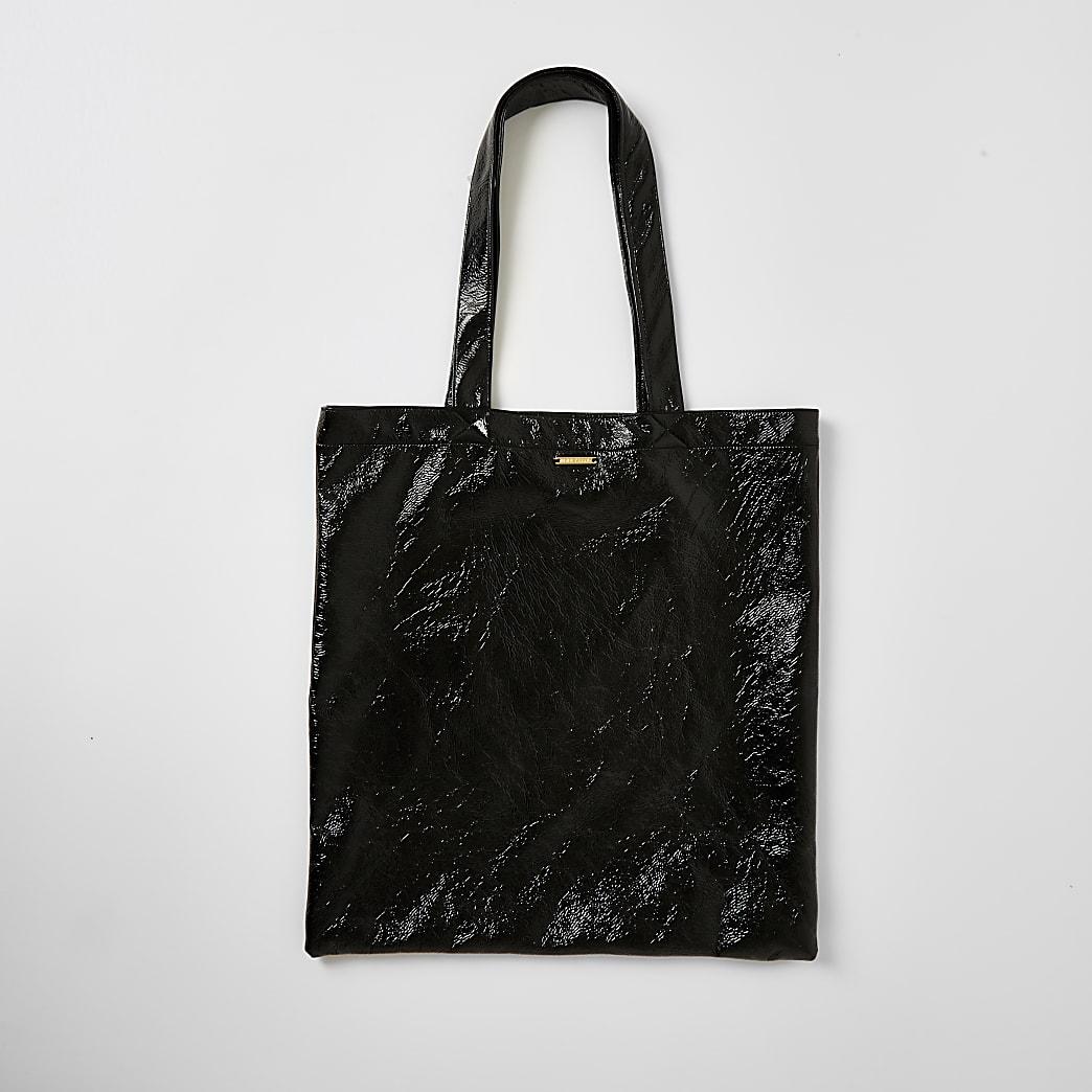 Black patent textured tote bag