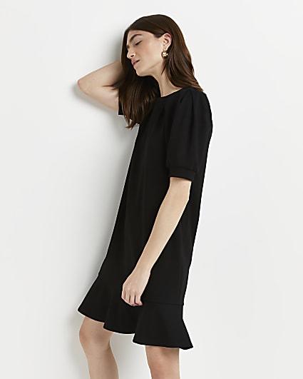 Black peplum hem mini dress