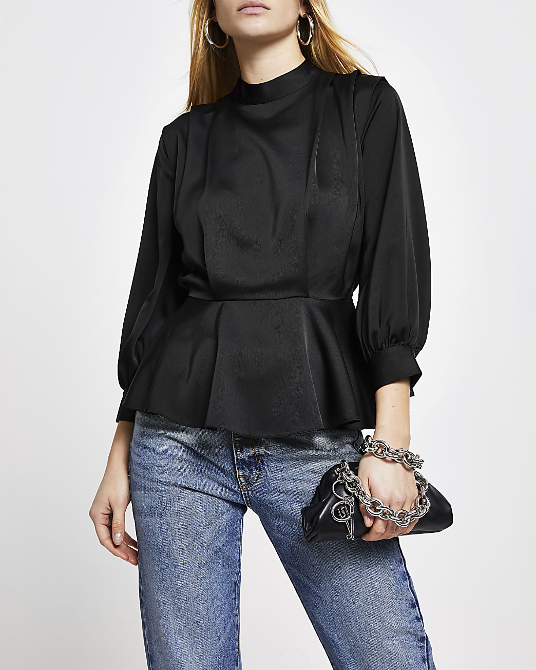 Black peplum pleat long sleeve top