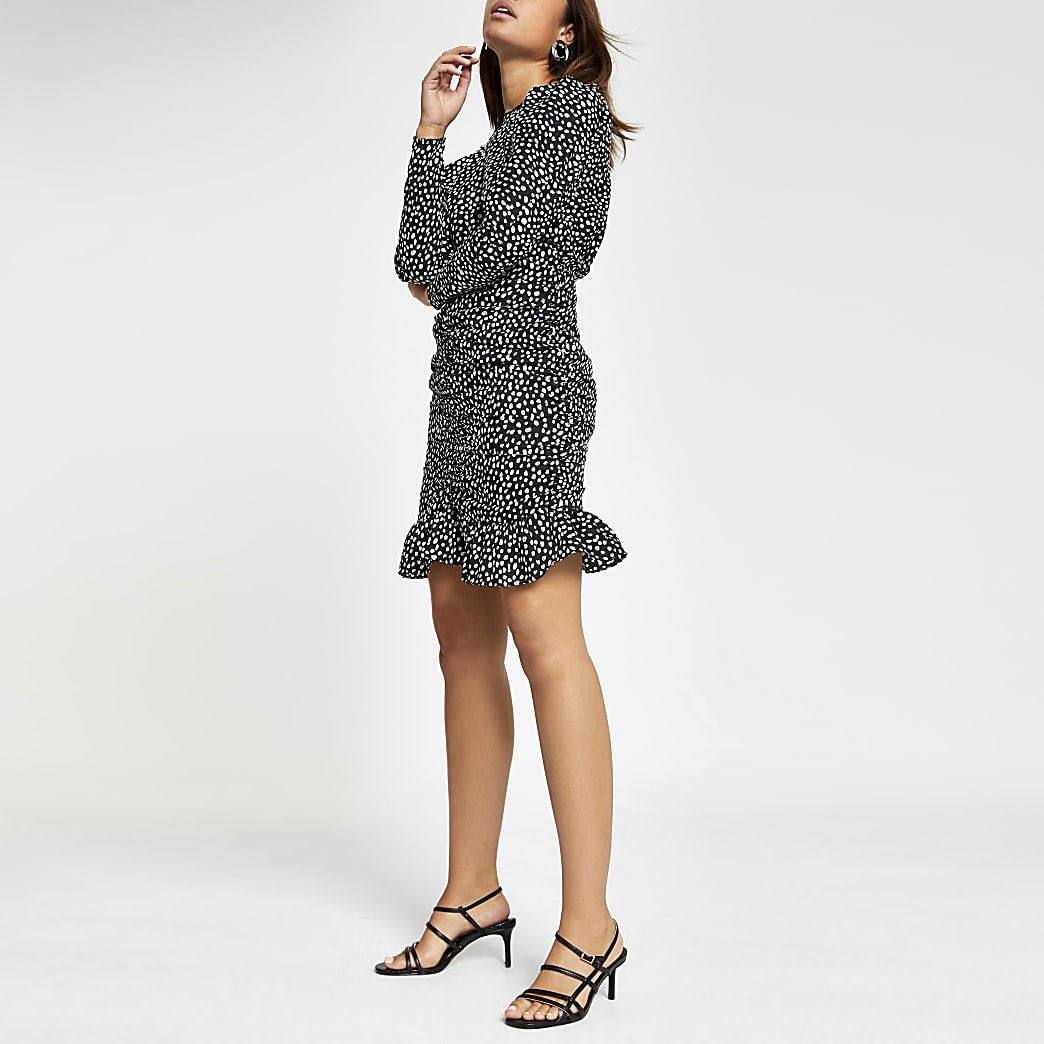 Black polka dot ruched mini dress