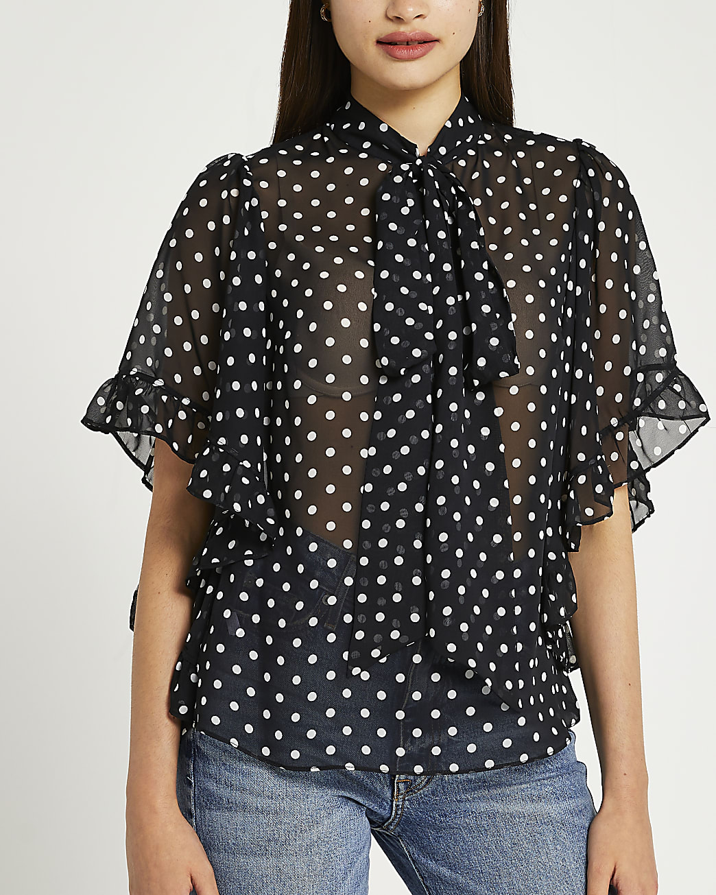 Black polka dot ruffled blouse