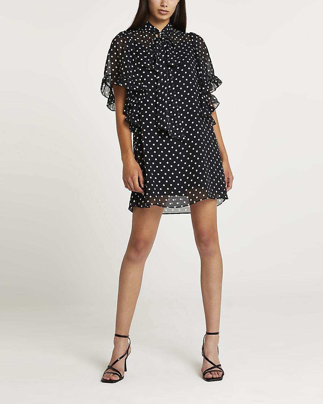 Black polka dot tie neck mini dress