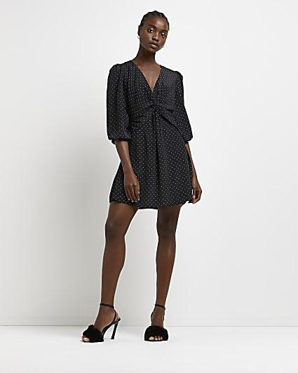 Black polka dot twist front mini dress