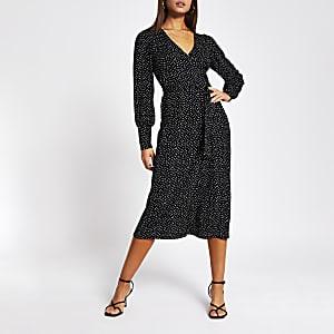 Zwarte midi-jurk met stippen, overslag en strik