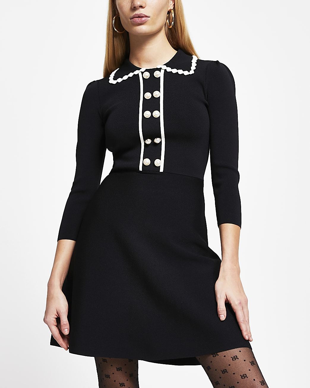Black polo neck knitted pearl button dress