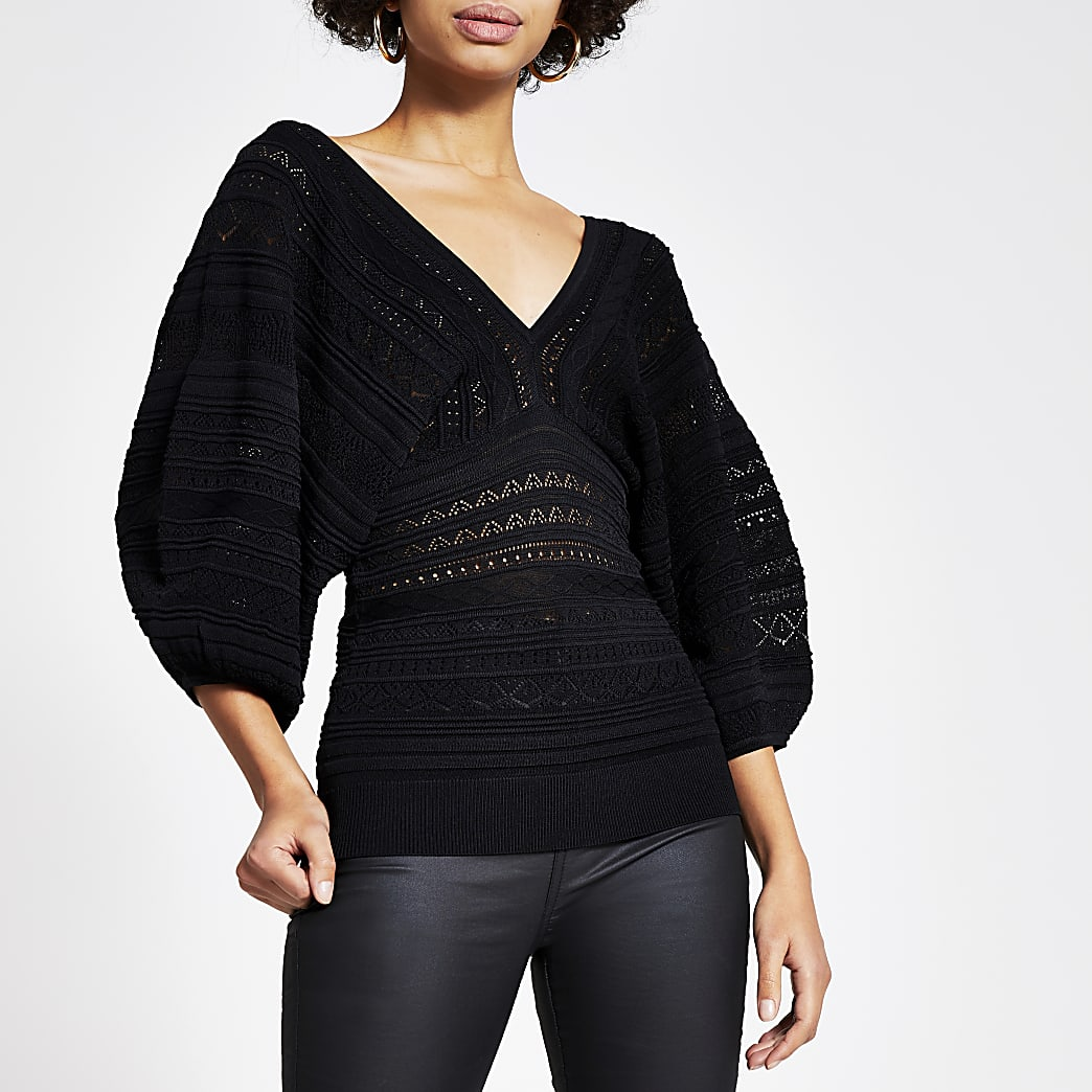 Haut noirà manches ballon et jolis points de tricot