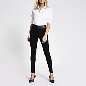 Zwarte smaltoelopende broek van PU en ponté-stof