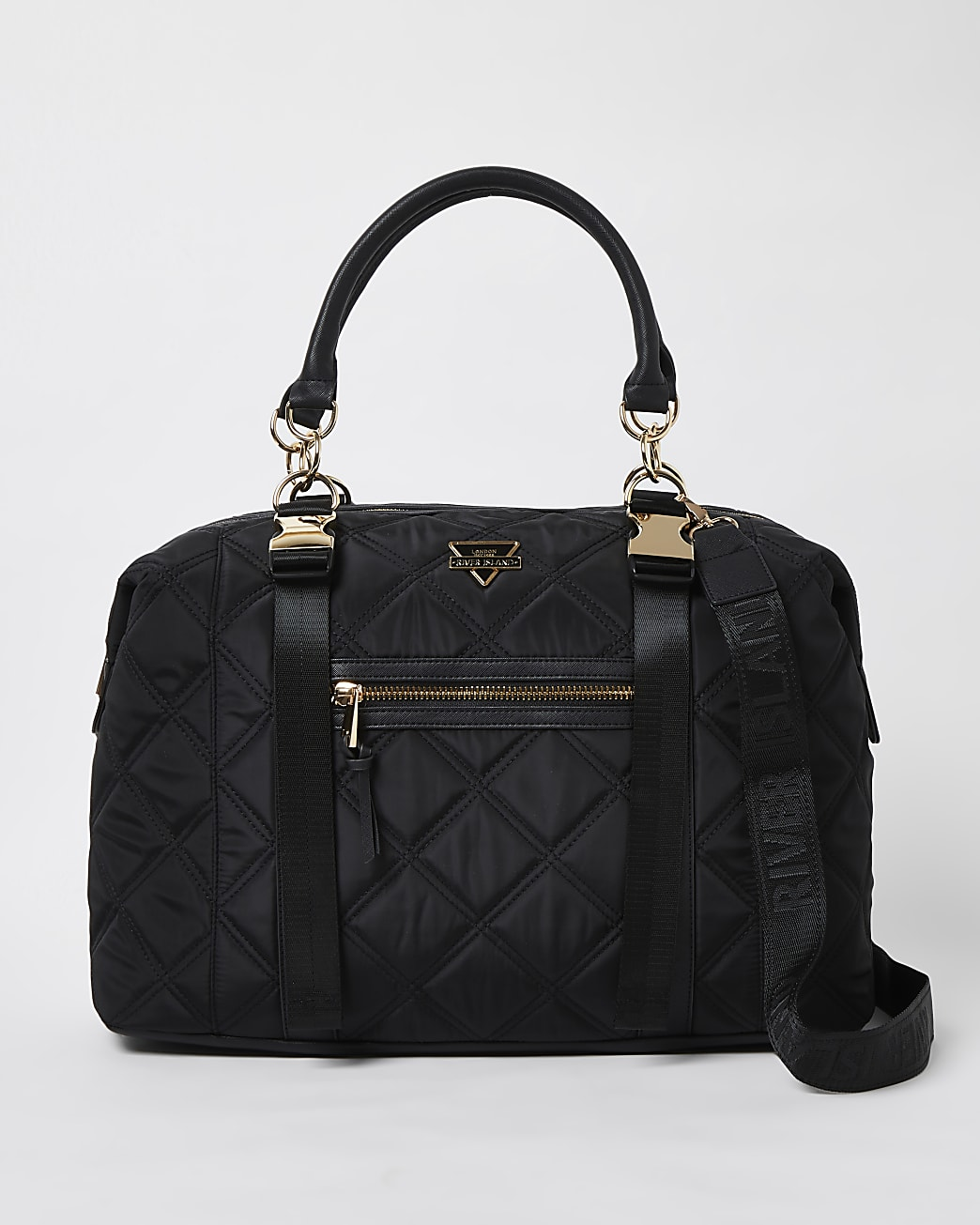 Black quilted holdall bag