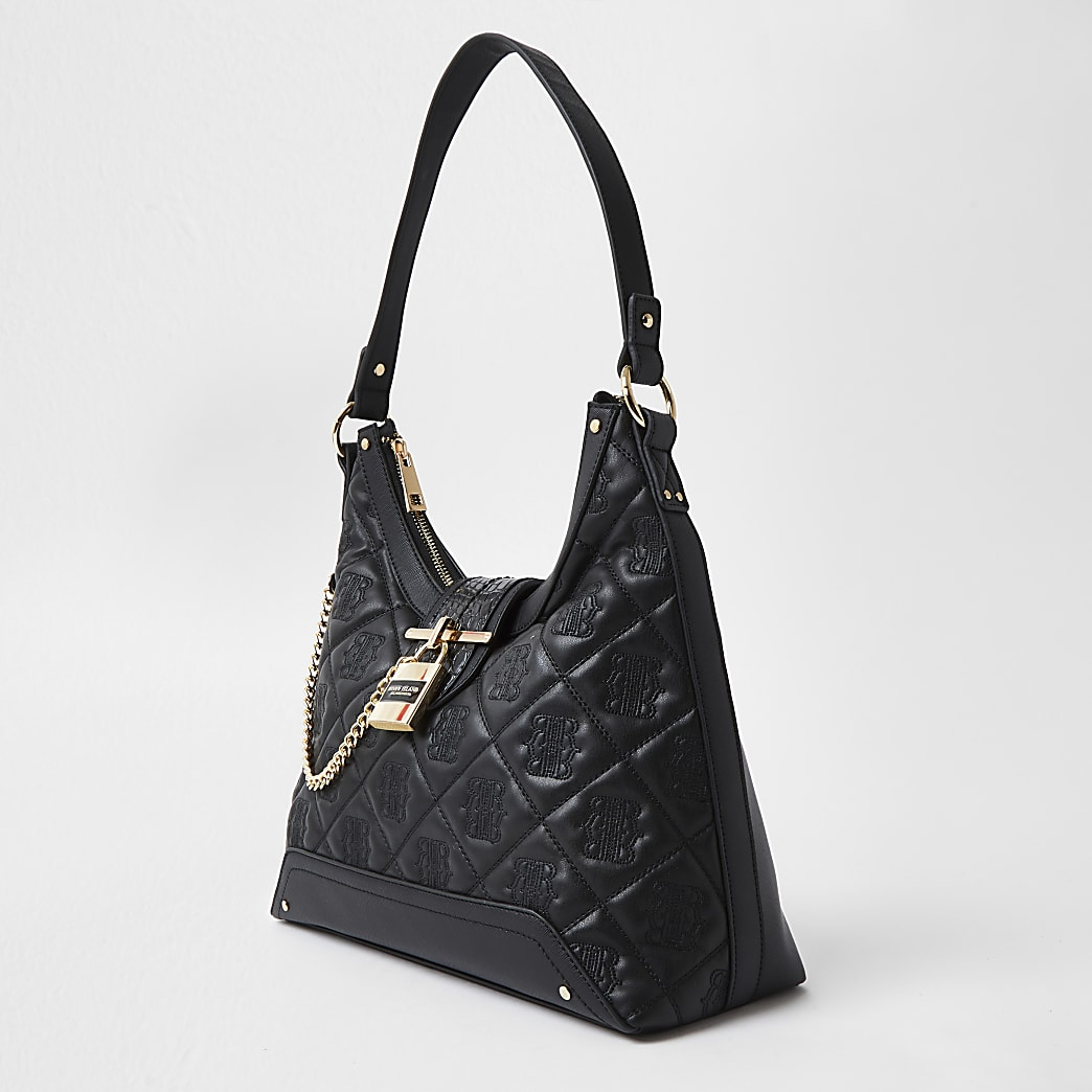Black quilted padlock slouch bag