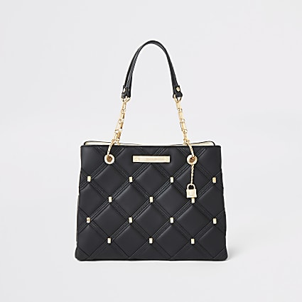 Black quilted studded tote bag