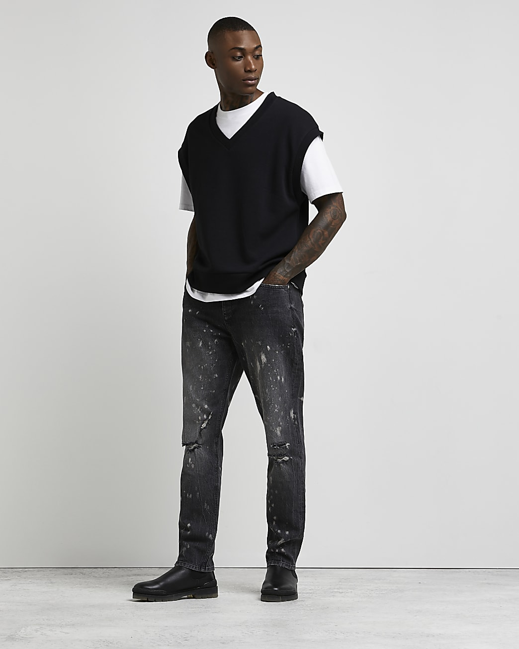 Black relaxed fit splatter ripped jeans