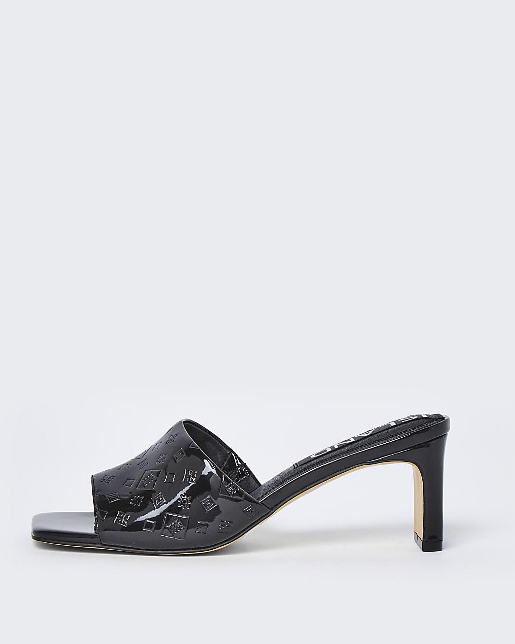 Black RI embossed block heel mules