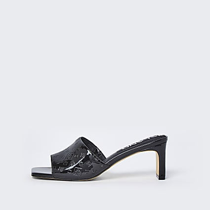 Black RI embossed block heel mules