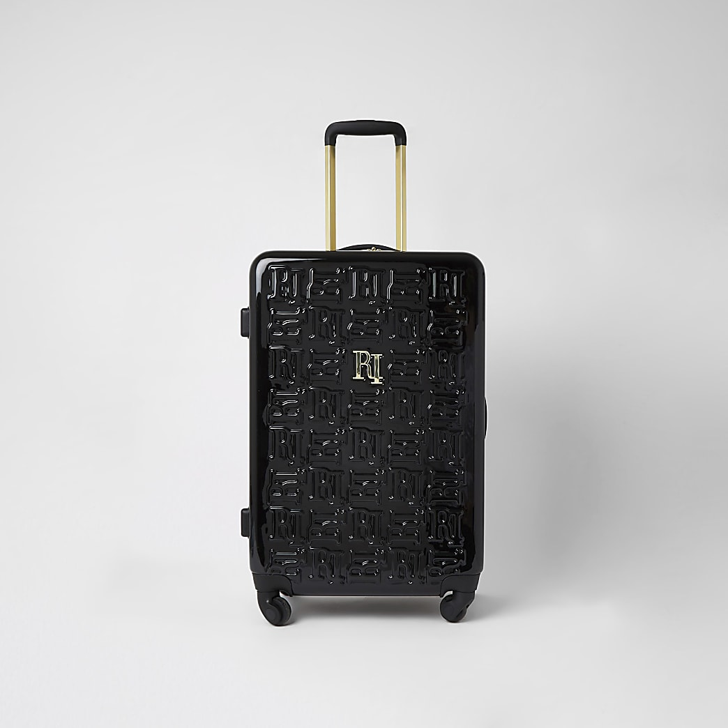 Schwarzer, mittelgroßer Koffer mit RI-Prägung