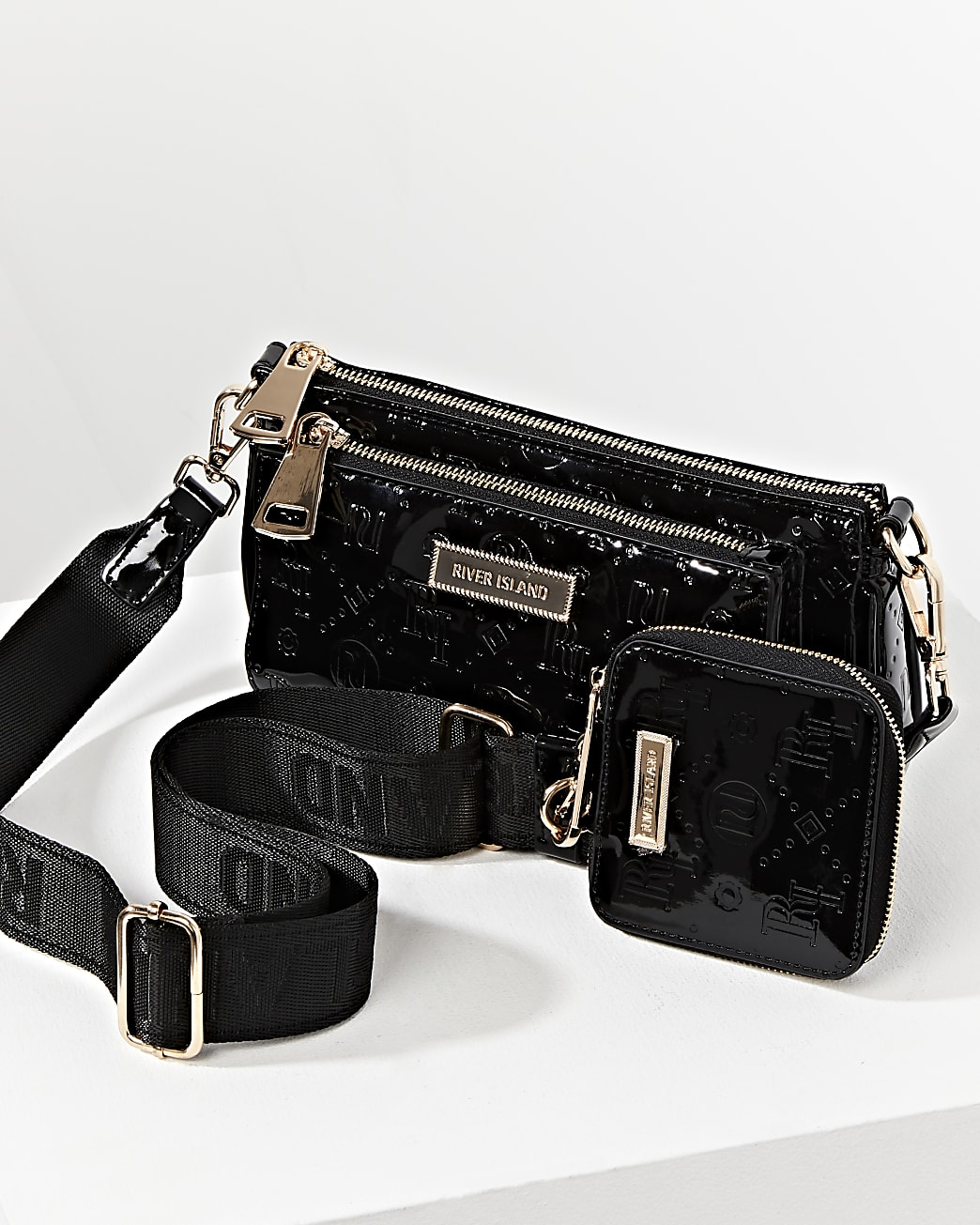 Black RI embossed pouchette cross body bag