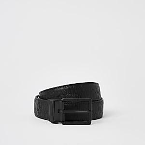 Zwarte omkeerbare riem met RI-print in reliëf