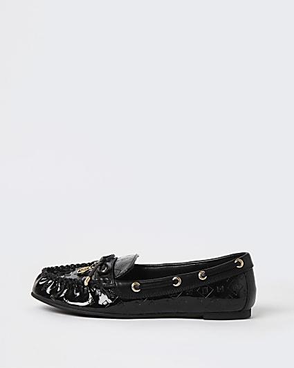 Black RI monogram embossed loafers