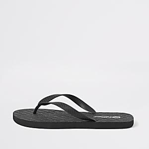 Schwarze Flip Flops