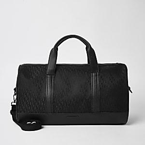 Schwarze Jacquard-Reisetasche mit RI-Monogramm-Muster