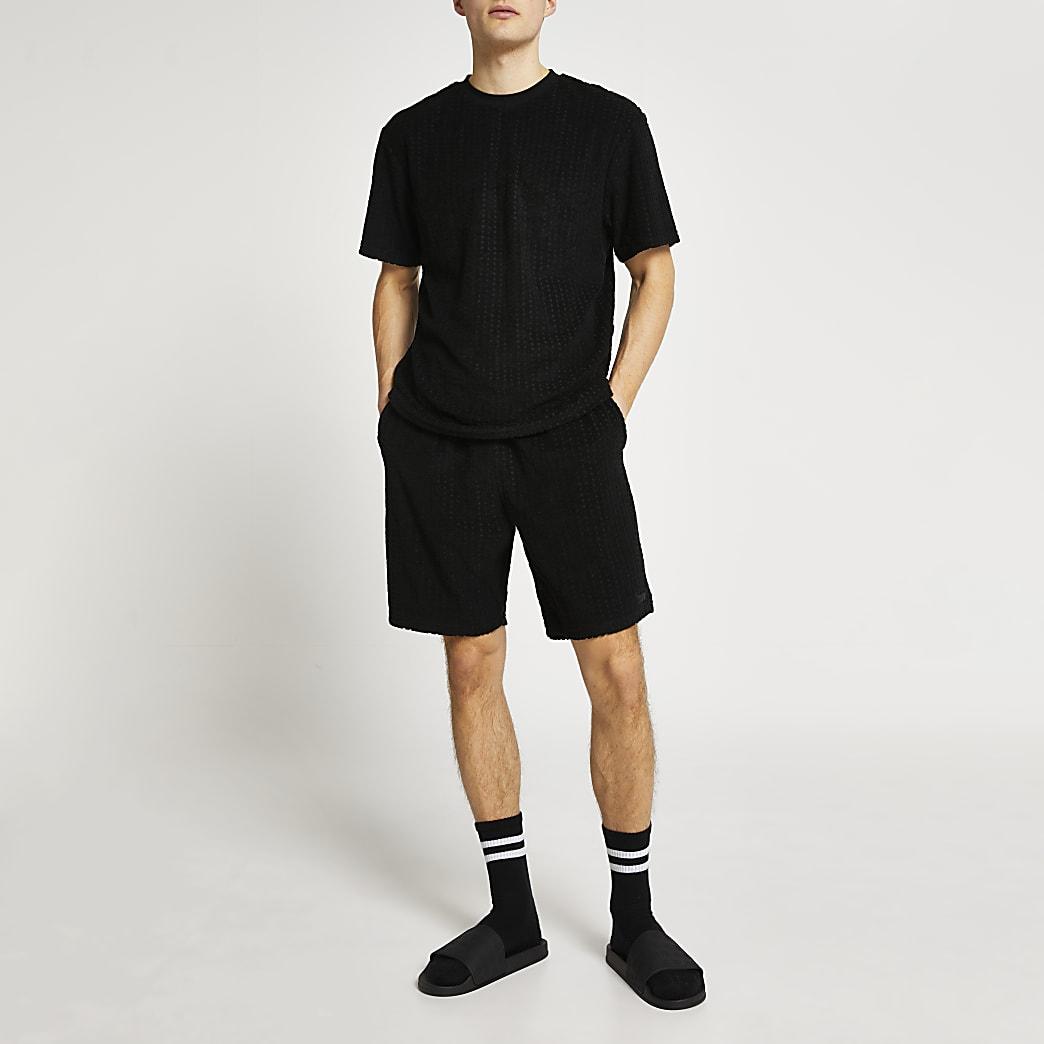 Black RI monogram towelling shorts