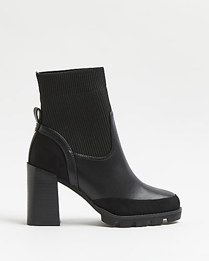 Black ribbed knit heeled ankle boots
