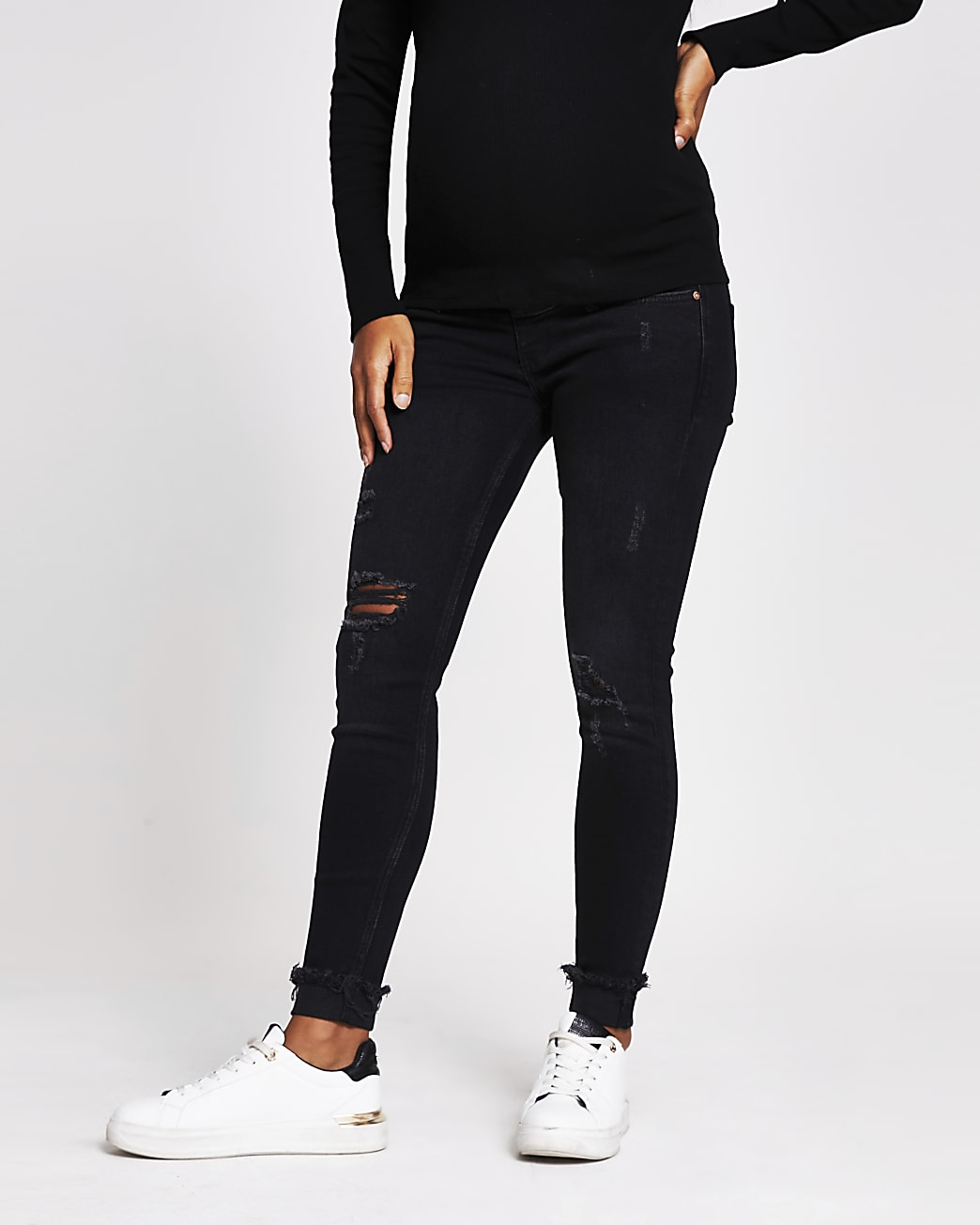 Black ripped mid rise maternity skinny jeans