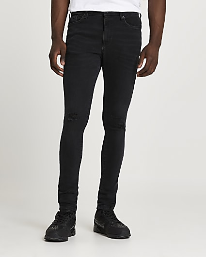 Black ripped spray on skinny fit jeans