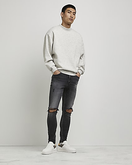 Black ripped spray on super skinny jeans