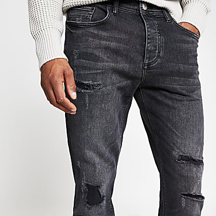 Black ripped tapered fit jeans
