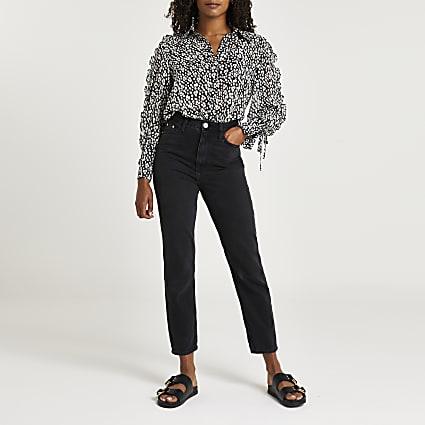 Black ruffled long sleeve shirt