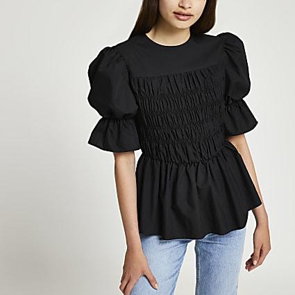 Black shirred peplum puff sleeve top