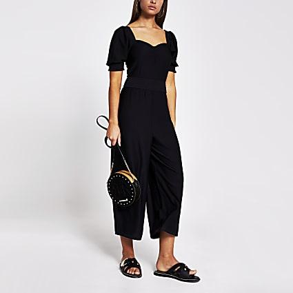 Black short sleeve floral waisted jumpsuit