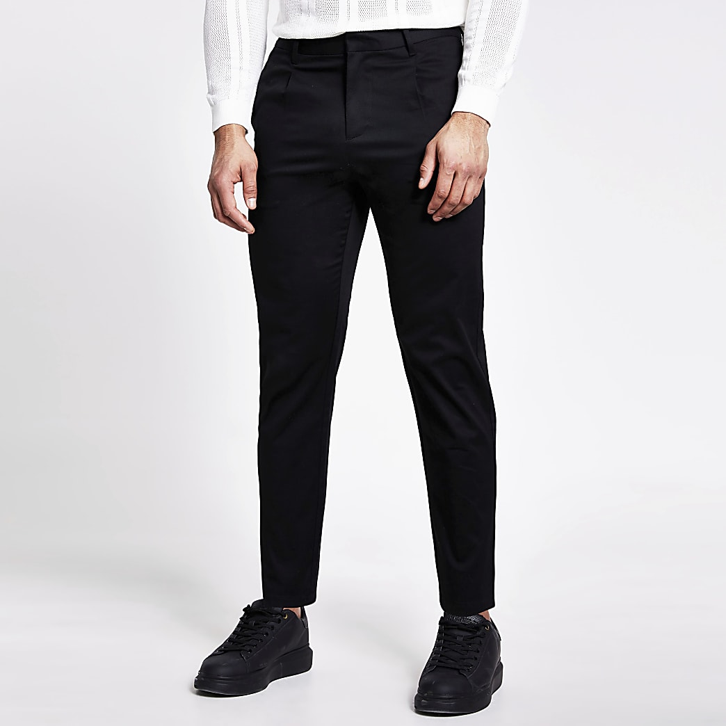 Zwarte tapered fit broek met enkele plooi