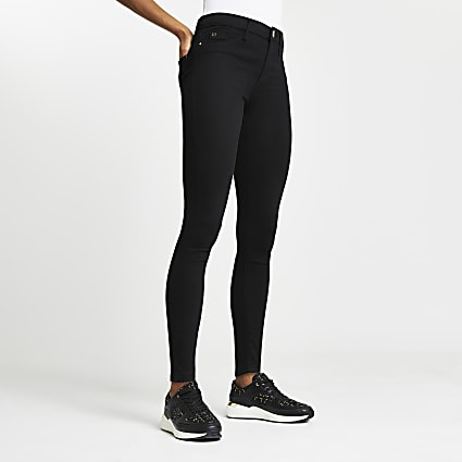 Black skinny mid rise Molly jeggings