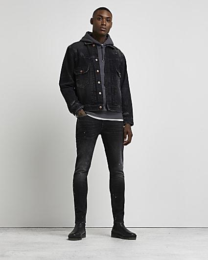 Black skinny paint splatter jeans