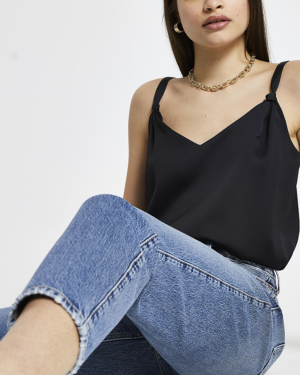 Black sleeveless cami knot detail top