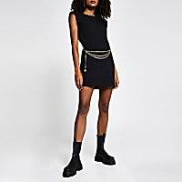 Black sleeveless shoulder pad t-shirt dress