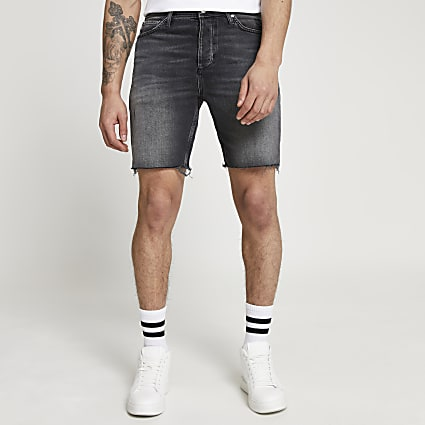 Black slim fit raw hem denim shorts