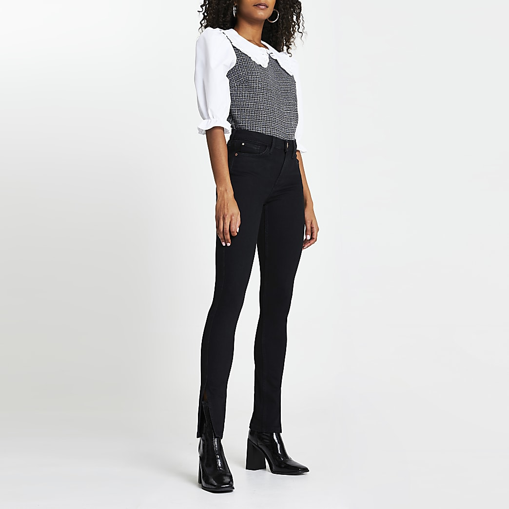 Black slim high rise split hem jeans